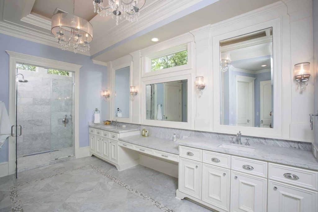 new-orleans-master-bathroom-double sink-ornate-chandelier